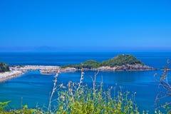 Haven en eiland Stock Foto's