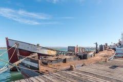 Haverier av avrivna ner fiskebåtar på Laaiplek Arkivfoto