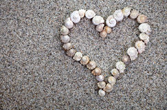 Havet beskjuter hjärta Arkivbild