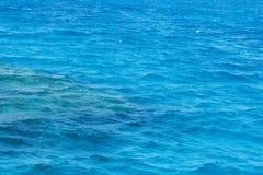 Havet bevattnar - texturera arkivbild
