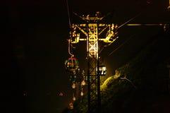 Havet parkerar kabelbilen på natten Fotografering för Bildbyråer