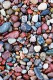 Havet stenar bakgrund Arkivfoto