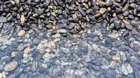 Havet stenar bakgrund Fotografering för Bildbyråer