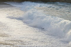 Havet vinkar och sand Arkivfoton