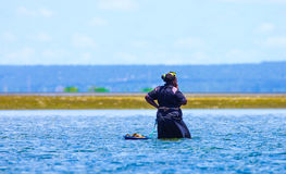 Having abreak while collecting mussels in Mozambique coast royalty free stock images