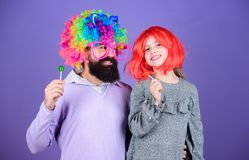Having the best day ever. Happy birthday. Father and daughter in party style wigs. Happy family celebrating birthday. Father and girl child enjoying birthday royalty free stock images