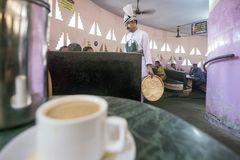 Indian Coffee House Maveli Cafe, Thiruvananthapuram. Having coffee in the heritage Indian Coffee House Maveli Cafe in Thiruvananthapuram, Kerala. The Indian Royalty Free Stock Images
