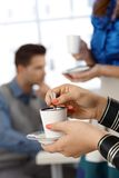 Having coffee in office Royalty Free Stock Photos