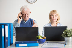 Having a company. Two elderly people having their own company Stock Images
