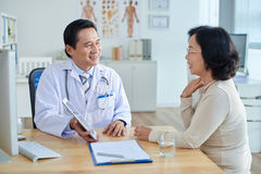 Having Consultation at Doctors Office Royalty Free Stock Photos