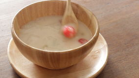 Having dessert with water chestnut in coconut cream stock video