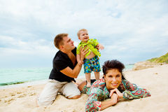 Having fun. Mom, son and dad having fun on the seashore Stock Photography