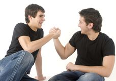 Having fun. Two young teenagers having fun on white background Royalty Free Stock Photos