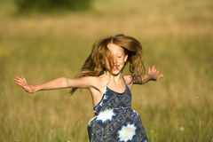 Having fun. Young redhead girl having fun in fields on a sunny sumer day Royalty Free Stock Images