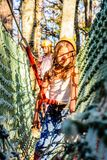 Having fun in the Adventure Park. Little girl is climbing in the adventure park Royalty Free Stock Photo