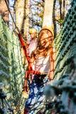 Having fun in the Adventure Park. Little girl is climbing in the adventure park royalty free stock photo