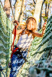 Having fun in adventure park. Little girl is climbing in adventure park royalty free stock image
