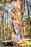 Having fun in adventure park. Little girl is climbing in adventure park stock photography