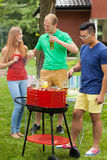 Having fun on a barbecue Royalty Free Stock Photography