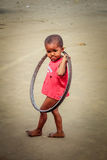 Having fun with the bicycle wheel rim Royalty Free Stock Photos