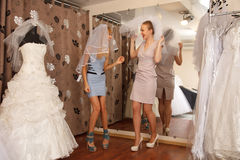 Having fun in bridal Boutique Stock Images