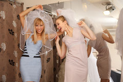 Having fun in bridal Boutique Stock Image