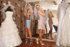 Having fun in bridal Boutique Royalty Free Stock Image