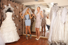 Having fun in bridal Boutique Stock Photo