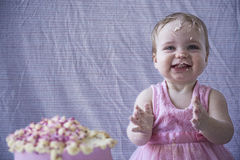 Having fun with cake happy baby girl Royalty Free Stock Photo