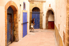 Having fun in Essaouira. Children having fun in the narow streets in the beautiful old port city of Essaouira, Morocco Royalty Free Stock Images