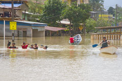 Having Fun in Flood Water. Villagers having fun with their families in the flood water. Heavy rains cause irregular flood in Rantau Panjang, Malaysia - Thai Royalty Free Stock Images