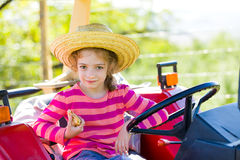 Having fun on grandfather 's tractor Stock Photo