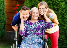Having Fun with Grandmother. Kind old grandmother having fun with beautiful grandchildren Royalty Free Stock Images
