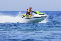 Having fun on a jet-ski. Young man having fun on a jet-ski Royalty Free Stock Images