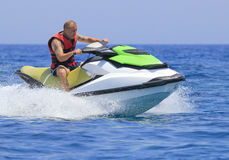 Having fun on a jet-ski. Young man having fun on a jet-ski Royalty Free Stock Photo