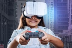 Happy little girl playing a virtual game Stock Images