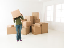 Having fun while moving in new house Royalty Free Stock Photos