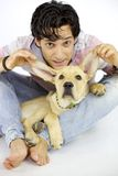 Having fun with my puppy dog. Playing with cute labrador retriever puppy dog Royalty Free Stock Image