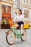 Having fun with new bicycle. Royalty Free Stock Photography
