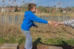Having fun outdoors. Young boy climbing on playground Royalty Free Stock Photos