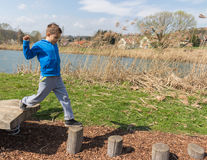 Having fun outdoors. Young boy climbing on playground Stock Images