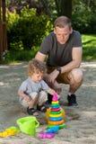 Having fun on playground. Dad and son having fun on playground Royalty Free Stock Photos