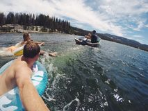 Having fun playing in the lake Stock Image