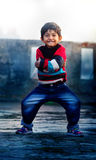 Having fun- Portrait of boy child playing on roof Stock Image