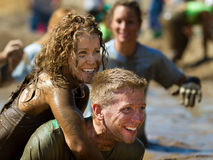 Having fun during the race. BOISE, IDAHO/USA - AUGUST 10: Unidentified couple smiling after finishing the The Dirty Dash in Boise, Idaho on August 10, 2013 Royalty Free Stock Image