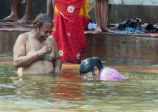 Having fun during ritual bathing in the Ganges River. Stock Photography