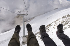 Having fun in a ski chairlift Stock Image