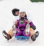 Having fun in snow. With sledge Stock Images