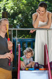 Having fun with soap bubbles. Family having fun with soap bubbles, vertical Stock Images