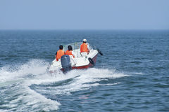Having fun with a speedboat. In the sea shore Stock Photos